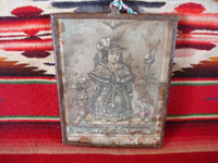 Mexican vintage devotional art, and Mexican vintage tinwork art, a tin nicho with a lovely image of the Santo Nino de Atocha, c. 1930's. Main photo of the Santo Nino de Atocha, seated on his chair.
