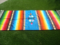 Mexican vintage textiles, and Mexican Saltillo sarapes (serapes), a wonderful Saltillo-style sarape with beautiful flowers serving as the center medallion, and with stunning color combinations creating a rainbow effect, c. 1940's. Side view of the sarape.