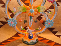 Mexican vintage folk art, and Mexican vintage pottery and ceramics, a wonderful pottery tree-of-life with beautiful and very colorful decorations, Izucar de Matamoros, Puebla, c. 1950's. Closeup photo of the base of the tree.