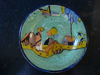 Mexican vintage pottery and ceramics, a lovely pottery plate with a pale, apple-green glaze and wonderful, crisp artwork, attributed to the great Balbino Lucano, Tonala or San Pedro Tlaquepaque, Jalisco, c. 1930's.  Main image of plate.
