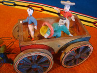 Mexican vintage folk art, and Mexican vintage pottery and ceramics, a wonderful pottery cart or carriage, pulled by two horses and filled with happy campesinos, attributed to the great folk artist, Candelario Medrano, Santa Cruz de las Huertas, Jalisco, c. 1940's.  Closeup photo of the happy passengers in the cart.