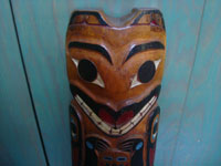 Native American Indian folk art and woodcarvings, a beautiful Northwest Coast large totem pole or house post, Haida, Queen Charlotte Islands, c. 1940's. Closeup photo of the face of the bear, at the top of the pole.