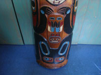 Native American Indian folk art and woodcarvings, a beautiful Northwest Coast large totem pole or house post, Haida, Queen Charlotte Islands, c. 1940's. Photo of the images near the bottom of the pole, an eagle and what is perhaps a beaver.