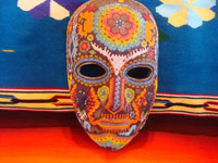 CI-13: Mexican vintage woodcarvings and masks, a beautiful beaded Huichol mask with very intricate and crisp design elements, the Sierras of Nyarite, c. 1950's. Main photo of the Huichol beaded mask.