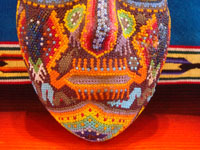 CI-13: Mexican vintage woodcarvings and masks, a beautiful beaded Huichol mask with very intricate and crisp design elements, the Sierras of Nyarite, c. 1950's. Closeup photo of the bottom part of the mask, near the mouth.