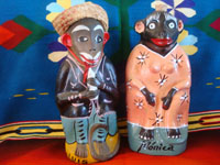 "Mexican vintage folk art, and Mexican vintage pottery and ceramics, a wonderful pair of pottery bottles in the form of whimsical and colorful ""monos"" or monkeys, Oaxaca, c. 1950's. Main photo of the bottles."