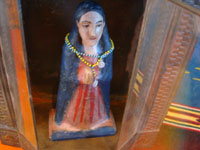 Mexican vintage devotional art, and Mexican vintage tinwork art, a lovely tinwork and glass nicho with a carved wooden image of Our Mother Mary, c. 1930's. Closeup photo of the Madonna inside of the tinwork art nicho.