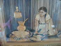 Mexican vintage straw art, popote art or popotillo, a very fine straw-art picture of a Mexican woman preparing masa to put tortillas on the comal, attributed to the great artist G. Olay, c. 1930's.  Closeup photo of the woman preparing masa.