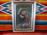 Mexican and New Mexican vintage devotional art, a New Mexican tin retablo painted with the images of St. Joseph and the Child Jesus, New Mexico, c. 1930's. Main photo of the New Mexican retablo.