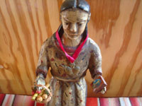 Mexican vintage devotional art, and Mexican vintage woodcarvings and masks, a wonderful wood-carved bulto (statue) depicting St. Elizabeth of Hungary, c. 1930. Closeup photo of the statue's face.