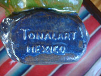 Mexican vintage folk art, and Mexican vintage pottery and ceramics, a lovely glazed statue of a Mexican gentleman relaxing and peering over the edge of his wonderful serape (sarape), Tonala or San Pedro Tlaquepaque, c. 1940.  Photo of the bottom of the piece, stamped with Tonala Mexico.""