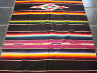 Closeup photo of the vintage Mexican textile, a Saltillo Sarape.