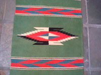 New Mexican vintage textile, a weaving from Chimayo, c. 1940. Closeup photo of center of textile.