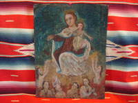 Mexican vintage devotional art and folk art, a retablo on tin depicting Our Lady of Mt. Carmel of the Scapulars, holding the Infant Jesus wearing his crown, c. 1900. Main photo.