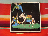 Mexican vintage pottery and folk art, a blackware tile with a scene of a very endearing and whimsical burro amidst plants and foliage, Tlaquepaque, Jalisco, c. 1930's. Main photo of the front of the entire tile.