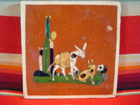 Mexican vintage pottery and folk art, a tile with terra cotta colored field and with a scene of a burro and doggie, Tonala, Jalisco, c. 1940's. Main photo of the entire front side of the tile.