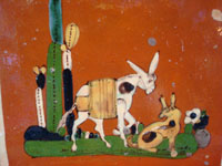 Mexican vintage pottery and folk art, a tile with terra cotta colored field and with a scene of a burro and doggie, Tonala, Jalisco, c. 1940's. Closeup photo of the burro and doggie.