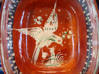 Mexican vintage pottery and ceramics, a lovely bandera-ware rectangular dish with a graceful eagle, Tonala or Tlaquepaque, Jalisco, c. 1930's. The dish is in the traditional colors of bandera-ware, earthen-red, green, and white, the colors of the Mexican flag, or bandera in Spanish. Closeup photo of the eagle.