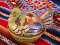 Mexican vintage pottery and ceramics and Mexican vintage folk-art, a lidded casserole in the form of a lovely green, nesting turkey, Tlaquepaque, c. 1940's. The green glaze and complimentary colors of the turkey's wings and feathers are very unique and wonderful. A side view of the Tlaquepaque turkey casserole.