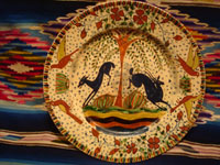 Mexican vintage pottery and ceramics, a magnificent Tlaquepaque plate with a starry-night background and decorated with leaping animals and birds, Tlaquepaque, Jalisco, c. 1920-30's. Attributed to the famous artist of that period, Balbino Lucano, or to his equally talented brother, Tomas Lucano. Another full-front view of the Tlaquepaque pottery plate attributed to Balbino Lucano or his brother Tomas.