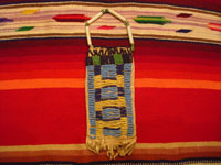 Native American Indian antique beadwork and folk-art, a Lakota (Sioux) beaded ration-pouch, c. 1890-1900. The beadwork on the pouch is very fine, and the pouch has a handle of lovely glass beads. Main photo of Lakota beadwork pouch.