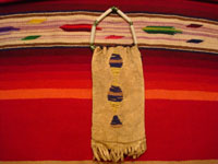 Native American Indian antique beadwork and folk-art, a Lakota (Sioux) beaded ration-pouch, c. 1890-1900. The beadwork on the pouch is very fine, and the pouch has a handle of lovely glass beads. Photo of the back side of the Lakota beaded leather pouch.