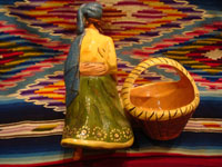 Mexican vintage pottery and ceramics and Mexican vintage folk-art, a lovely pottery figurine depicting a lovely woman with a basketl, Tonala or Tlaquepaque, Jalisco, c. 1930's. The woman's face is incredibly beautiful. Photo of the back side of the Tonala or Tlaquepaque pottery maiden with basket.