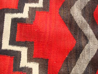 Native American Indian vintage weaving and textiles, and Navajo vintage rugs and blankets, a fabulous Navajo wearing blanket, Arizona or New Mexico, c. 1900. Closeup photo showing the tightness of the weave of this Navajo wearing blanket.