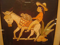 Mexican vintage straw-art (popote art or popotillo), a wonderful popote art scene of a boy riding his trusty burro, laden with goods, to the local market, c. 1940's. This piece of Mexican popote art is comprised of thousands of minute pieces of dyed straw; this is very labor intensive and wonderful! Main photo.