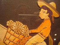 Mexican vintage straw-art (popote art or popotillo), a wonderful popote art scene of a boy riding his trusty burro, laden with goods, to the local market, c. 1940's. This piece of Mexican popote art is comprised of thousands of minute pieces of dyed straw; this is very labor intensive and wonderful! Closeup view of the boy's face.