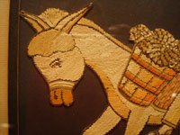 Mexican vintage straw-art (popote art or popotillo), a wonderful popote art scene of a boy riding his trusty burro, laden with goods, to the local market, c. 1940's. This piece of Mexican popote art is comprised of thousands of minute pieces of dyed straw; this is very labor intensive and wonderful! Closeup view of the burro's wonderful face.
