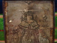 Mexican vintage devotional art, and Mexican vintage tinwork art, a lovely tinwork nicho with a very old printed image of the Santo Nino de Atocha, c. 1930's. Closeup photo of the image of the Santo Nino.