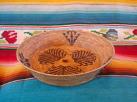 Native American Indian baskets, a fantastic Mission basket, very possibly Cahuilla, with a wonderful floral pattern, possibly Palm Springs or Santa Rosa Mountain area, c. 1920's. A side view of the California Mission Indian basket.