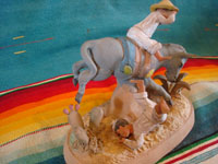 Mexican vintage folk art, and Mexican vintage pottery and ceramics, a very fine clay sculpture of a bucking mule or horse and its terrified rider, most probably from the famous Panduro family of Guadalajara, c. 1930's. Photo shot from behind the Panduro sculpture.