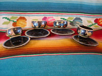 Mexican vintage pottery and ceramics, a set of 4 pottery cups and saucers, with a lovely blackware glazing and astounding artwork, San Pedro Tlaquepaque, Jalisco, c. 1930's. Main photo of the pottery cups and saucers from Tlaquepaque.