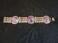 Mexican vintage sterling silver jewelry, and Taxco vintage silver jewelry, a beautiful and very graceful sterling silver bracelet with wonderful amethyst half-spheres, Taxco, c. 1940's. Main photo of the Taxco silver jewelry bracelet with amethyst.