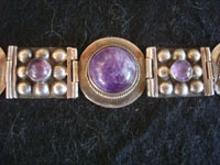 Mexican vintage sterling silver jewelry, and Taxco vintage silver jewelry, a beautiful and very graceful sterling silver bracelet with wonderful amethyst half-spheres, Taxco, c. 1940's. Closeup photo of a part of the Taxco silver bracelet.