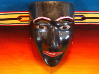 "Mexican vintage woodcarvings and masks, and Mexican vintage folk art, a wonderful carved and painted wooden ""Mask of the Negrito (Negro)"", used in the dance in winter in San Lorenzo, Michoacan, c. 1950.  Main photo of the mask."