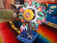 Mexican vintage folk art, and Mexican vintage pottery and ceramics, a lovely and very colorful pottery ferris wheel, filled with delighted people, Ocumicho, Michoacan, c. 1960's. A photo of the people and doggies at the base of the ferris wheel, awaiting a turn to ride.