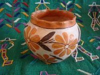Native American Indian vintage pottery, a beautiful Acoma pot with wonderful floral decorations and a fluted rim, Acoma Pueblo, New Mexico, c. 1940's. Main photo of the Acoma pot.