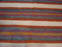 Native American Indian vintage textiles, and Navajo vintage textiles, rugs, and blankets, a beautiful Navajo woven-wool double saddle blanket, with beautiful colors and designs, Arizona or New Mexico, c. 1960's. Closeup photo of a part of the blanket showing the bright colors.