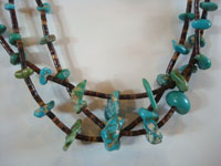 Native American Indian vintage jewelry, and Navajo vintage jewelry, a lovely three-strand necklace of turquoise and heishi, Arizona or New Mexico, c. 1950's. Closeup photo of a part of the necklace.