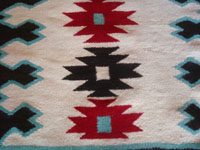 Native American Indian textiles, and Navajo vintage textiles and rugs, a wonderful Navajo rug with natural wools in cream and black, and aniline-dyed turquoise and red, Arizona or New Mexico, c. 1950's. Closeup photo showing the fine weave of the Navajo rug.