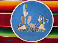 Mexican vintage pottery and ceramics, a lovely blue-ware plate from Tlaquepaque, Jalisco, c. 1940. The blue background glazing is very beautiful, and the rural scene on the plate is finely painted. It features a frolicking squirrel amidst plants and cacti. Main photo of the plate.