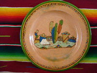 Mexican vintage pottery and ceramics, a lovely terra-cota plate from Tlaquepaque, Jalisco, c. 1940. The peach-colored background glazing is beautiful. The scene on the plate is exceptional; it features a snoozing campesino in a wonderful rural setting. Main photo of plate.