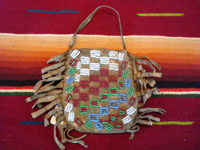 Native American Indian antique beadwork and folk art, a very finely beaded bag with some metallic beads, Plains, c. 1890-1900. The bag has a lovely checker-board pattern on one side, and a cross on the other.