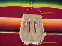 Native American Indian antique beadwork and folk art, a beautifully beaded Apache pouch (ration-ticket pouch), c. 1890. The ration pouch features two American flags on one side, and a wonderful checkerboard pattern on the other. Photo showing the American flags on one side of the beaded pouch.