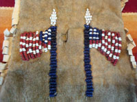 Native American Indian antique beadwork and folk art, a beautifully beaded Apache pouch (ration-ticket pouch), c. 1890. The ration pouch features two American flags on one side, and a wonderful checkerboard pattern on the other. A closeup photo of the two American flags on one side of the pouch.