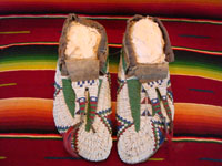 Native American Indian antique beadwork, a pair of Sioux (Lakota) beaded mocassins, c. 1890. The beadwork is exceptionally fine. The mocassins have a bi-furcated tongue. Main photo.