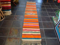 Mexican vintage textiles and sarapes, a lovely Saltillo sarape runner with a wonderful center design, c. 1940. Very beautifully woven of fine wool with silk in the center medallion and decorative side-bars. Main photo of runner.
